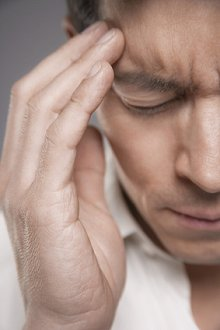 Reflexology and Nerve Reflexology. Library Image: Man with Headache